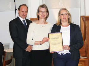"Dr. Gabriele Vielhaber (SVP BU Actives & Micro Protection CI at Symrise) and Dr. Marielle LeMaire (Global Product Manager Micro Protection CI at Symrise) accept the second prize in the category ""Cosmetics/ Raw Materials/actives"" for SymGuard® CD from Dr. rer. nat. Jan-H. Riedel (BSB)"